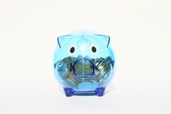 Saving pig half full of money Royalty Free Stock Photo