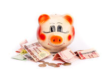 Saving,piggy bank. A piggy bank on white background Royalty Free Stock Photography