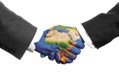 Saving the planet. Two hands shaking on a white background with a world map Stock Photography