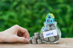 saving property or mortgage concept as Woman hand holding stack stock photos