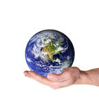 Saving and protecting the earth. Human hand holding earth in palm isolated on white background. Some components of this montage are provided courtesy of NASA royalty free stock photography