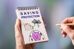 Saving protection concept on a notepad. Hand drawing saving protection concept on a notepad Royalty Free Stock Photography