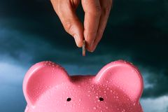Saving for a rainy day. Piggy bank saving concept royalty free stock photography