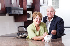 Saving for retirement. Happy senior couple saving for retirement royalty free stock photo