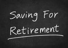 Saving for retirement. Concept text on blackboard background Stock Images
