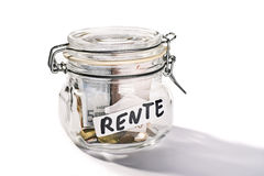 Saving for retirement. Preserving jar with savings for retirement and the german word Rente Stock Photos