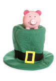 Saving for st patricks day. Piggybank with a st patricks day hat Stock Images