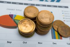 Saving stack coins money Charts and Graphs paper. Financial, Accounting, Statistics, Analytic research data and Business company m Stock Photos