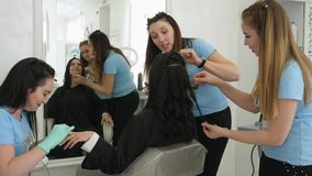 Saving time, business woman doing manicure during make-up and hairstyles in salon stock footage