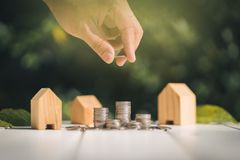 Saving to buy a house or home savings concept with money coin stack growing. Stock Image