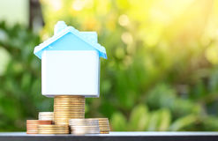 Saving to buy a house that stack coin growing ,yellow tone,savi. Ng money or money growth concept royalty free stock images
