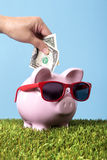 Piggy bank summer vacation retirement saving plan vertical Stock Image