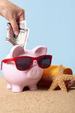 Saving for vacation or retirement, piggy bank, travel planning concept Royalty Free Stock Image