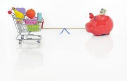Saving versus spending Royalty Free Stock Images