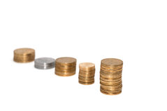 Saving your money. Stack of coins on white background Stock Photography