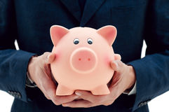 Saving your money in the right hands Stock Photo