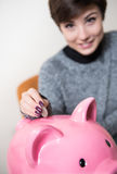 Savinges coin in the piggy box Royalty Free Stock Image