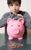 Savinges coin in the piggy box Stock Photos