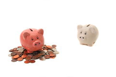 Savings. Pink  little piggy has some savings and white little piggy has none Stock Image