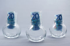 Savings. Euro banknotes in glass jars for savings royalty free stock photo