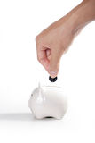 Savings. Piggybank and hand ,Isolated on white background Royalty Free Stock Photos