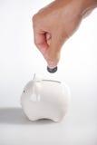 Savings. Piggybank and hand ,Isolated on white background Royalty Free Stock Image