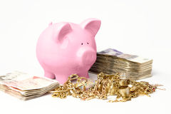 Savings. Piggy bank standing by savings Royalty Free Stock Photo