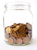 Savings. Glass jar with family savings Royalty Free Stock Photos