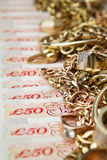 Savings. Golden jewelry on British Pounds stock photo