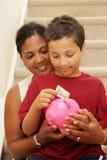Savings. Family Holding Piggy Bank With Their Savings stock photo