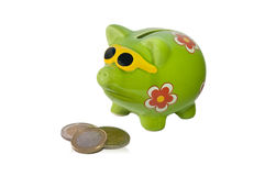Savings. Pig with some euro coins Stock Photos