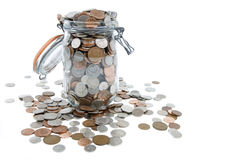 Savings. Jar full of British coins Royalty Free Stock Images