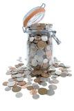 Savings. Jar full of British coins Stock Photo