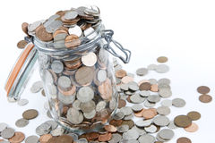 Savings. A glass jar full of British coins Royalty Free Stock Images