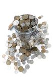 Savings. A glass jar full of British coins Stock Image