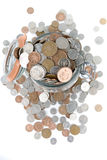 Savings. A glass jar full of British coins Stock Images