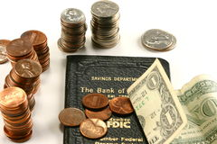 Savings Account. Passbook and stacks of coins and a dollar bill Royalty Free Stock Photography