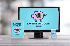 Savings account concept on different devices royalty free stock images