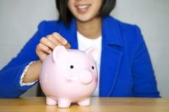 Savings.Adding to your savings Royalty Free Stock Photography