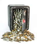 Savings Back. A child's savings back pack full of old coins. A life savings of old coins spill from the open vault. Old US coins including silver dollars royalty free stock photos