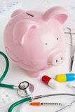 Savings Bank With Medical Equipment To Illustrate Health Insuran Stock Photos