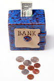 Savings bank with money Royalty Free Stock Photos