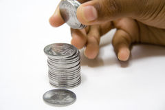 Savings Bit by Bit. Build a big fortune by saving coins bit by bit Stock Images