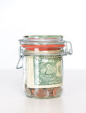 Savings box with dollars Stock Photography