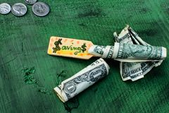 Savings and cash. Savings and budget and finance photography background with dollar bills growing with sprouting plants in organic earth conceptual financial royalty free stock photography