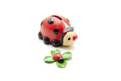 Savings can and ladybug on cloverleaf Stock Images
