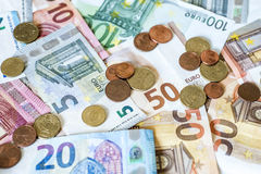 Savings Cash money concept euro banknotes all sizes and cent coins on desk Royalty Free Stock Photos