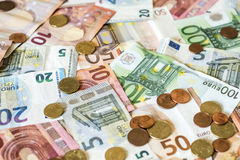Savings Cash money concept euro banknotes all sizes and cent coins on desk Royalty Free Stock Images
