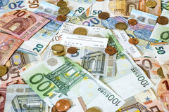 Savings Cash money concept euro banknotes all sizes and cent coins on desk bill pay store text sum total save. Savings Cash money concept euro banknotes of all Royalty Free Stock Photography