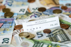 Savings Cash money concept euro banknotes all sizes and cent coins on desk bill pay store text sum total save. Savings Cash money concept euro banknotes of all Royalty Free Stock Photos